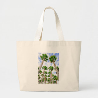 Group of high straight palm trees large tote bag