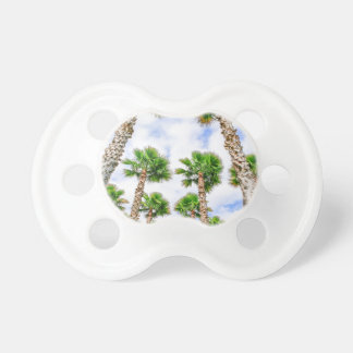 Group of high straight palm trees pacifiers