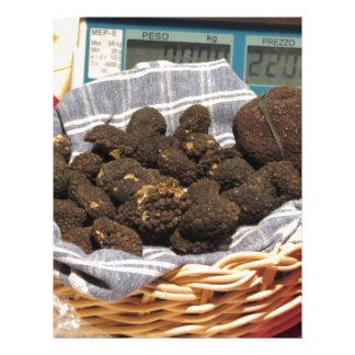 Group of italian expensive black truffles letterhead