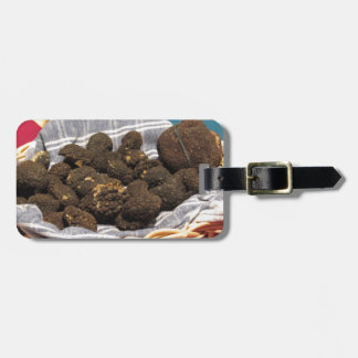 Group of italian expensive black truffles luggage tag