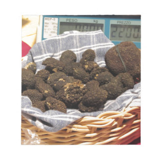 Group of italian expensive black truffles notepad