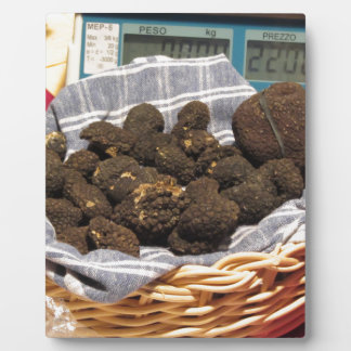 Group of italian expensive black truffles plaque