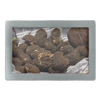 Group of italian expensive black truffles rectangular belt buckle