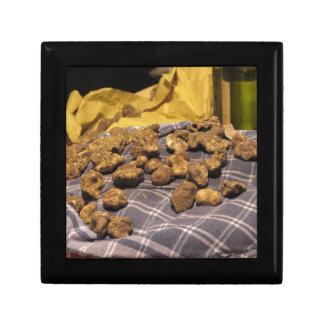 Group of italian expensive white truffles jewelry box