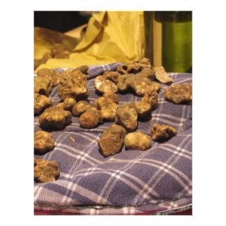 Group of italian expensive white truffles letterhead