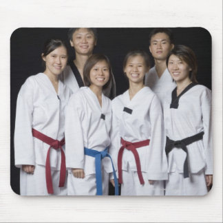 Group of martial arts player standing and mouse pad