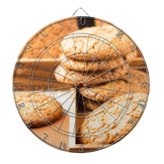 Group of oatmeal cookies on the wooden tray dartboard