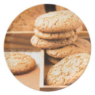 Group of oatmeal cookies on the wooden tray dinner plate