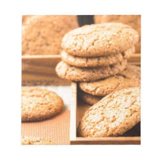 Group of oatmeal cookies on the wooden tray notepad