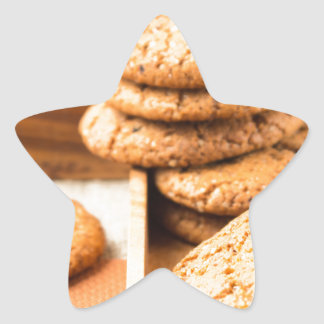 Group of oatmeal cookies on the wooden tray star sticker