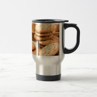 Group of oatmeal cookies on the wooden tray travel mug