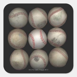 Group of old baseballs on black background square sticker