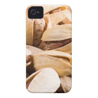 Group of salted pistachios in a small wooden box iPhone 4 cover