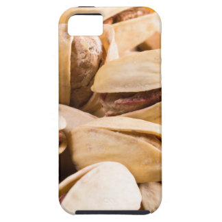 Group of salted pistachios in a small wooden box iPhone 5 cover