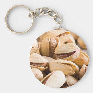 Group of salted pistachios in a small wooden box keychain