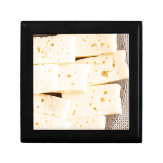 Group slices dry hard yellow cheese on a plate gift box
