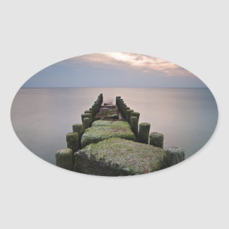 Groynes on shore of the Baltic Sea Oval Sticker