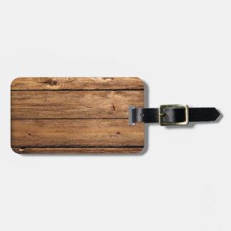 grundgy worn wood background luggage tag
