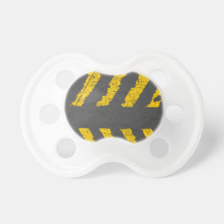 Grunge distressed yellow road marking pacifier