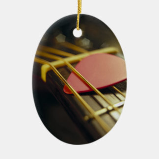 Guitar Pick Tucked in Strings Ceramic Oval Ornament