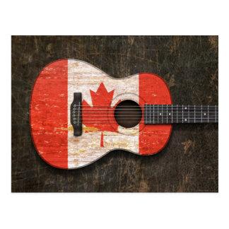 Guitare acoustique rayée et utilisée de drapeau carte postale