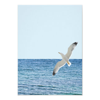 Gull flying above a sea card