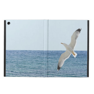 Gull flying above a sea iPad air cover