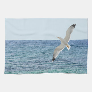 Gull flying above a sea kitchen towel