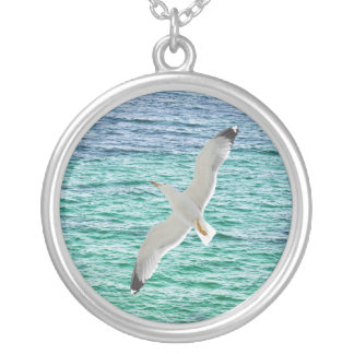 Gull flying above a sea silver plated necklace