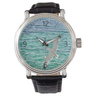 Gull flying above a sea wristwatch
