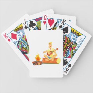 Guy Playing Guitar Sitting On A Log Next Bicycle Playing Cards