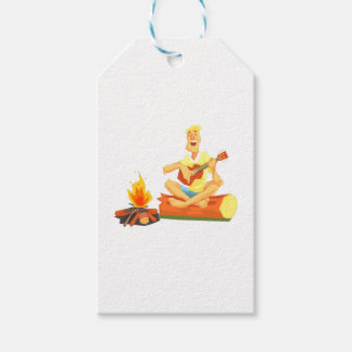 Guy Playing Guitar Sitting On A Log Next Gift Tags