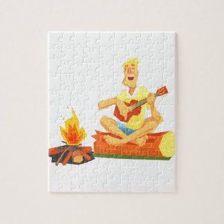 Guy Playing Guitar Sitting On A Log Next Jigsaw Puzzle