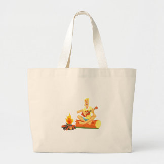 Guy Playing Guitar Sitting On A Log Next Large Tote Bag