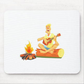Guy Playing Guitar Sitting On A Log Next Mouse Pad