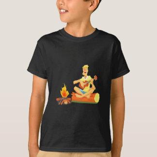 Guy Playing Guitar Sitting On A Log Next T-Shirt