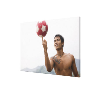 Guy spinning football on finger canvas print