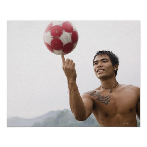 Guy spinning football on finger posters