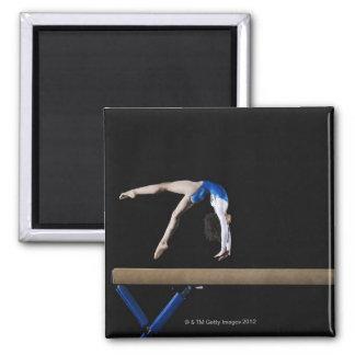 Gymnast (9-10) flipping on balance beam, side magnet