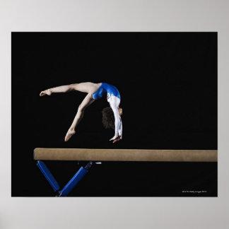 Gymnast 9-10 flipping on balance beam side poster