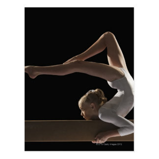 Gymnast on balance beam postcard