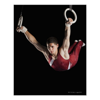 Gymnast swinging from rings poster
