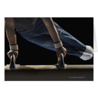 Gymnast swinging on pommel horse card