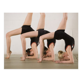 Gymnasts posing upside down postcard