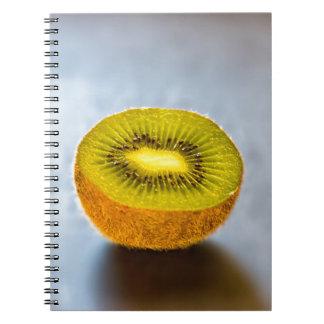 half Kiwi on the table Notebook