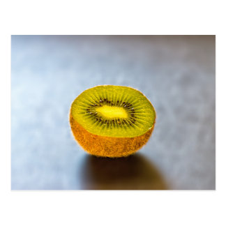half Kiwi on the table Postcard