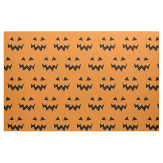 Halloween fabric with carved pumpkin face pattern