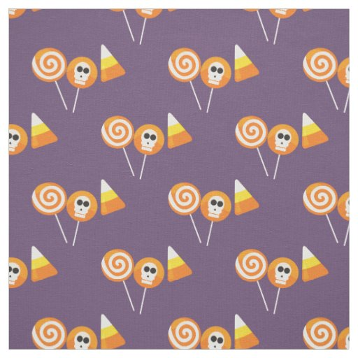 Halloween fabric with orange skulls, candy, cake