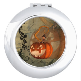 Halloween, funny pumpkin with cute witch makeup mirror