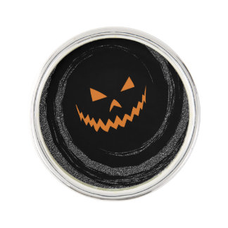 Halloween Glowing Jack O'Lantern in a black swirl Lapel Pin